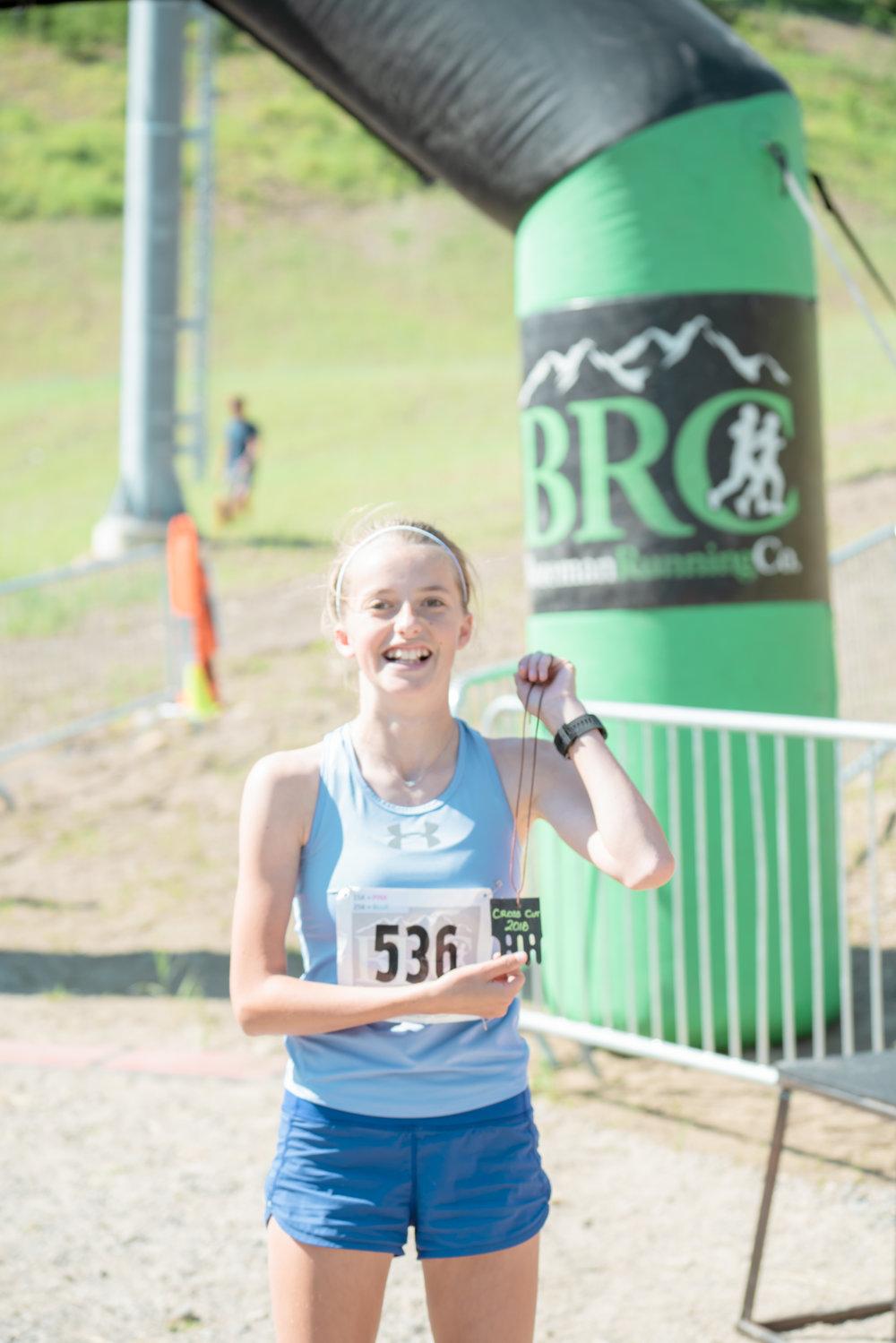 A runner getting her reward at Bozeman Running Co. racing of Crosscuts at Bridger Bowl just north of Bozeman, Montana.