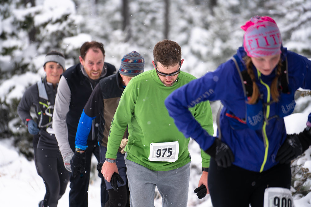 Runners battle winter snow that coats the Bridgers during Bozeman Running Co. racing of the Foothills 14k up Sypes Canyon. Beth Nanavati in front.