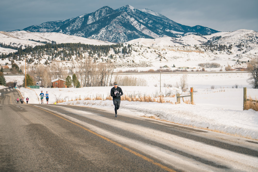 Striding it out below the the Bridger Mountains during Bozeman Running Co.'s racing of the Bear near Bozeman, Montana.