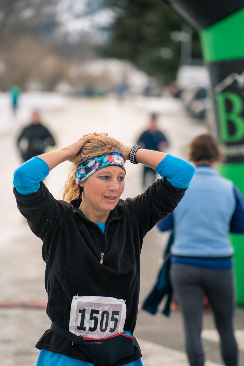 Crossing the finish line during Bozeman Running Co.'s racing of the Bear near Bozeman, Montana.