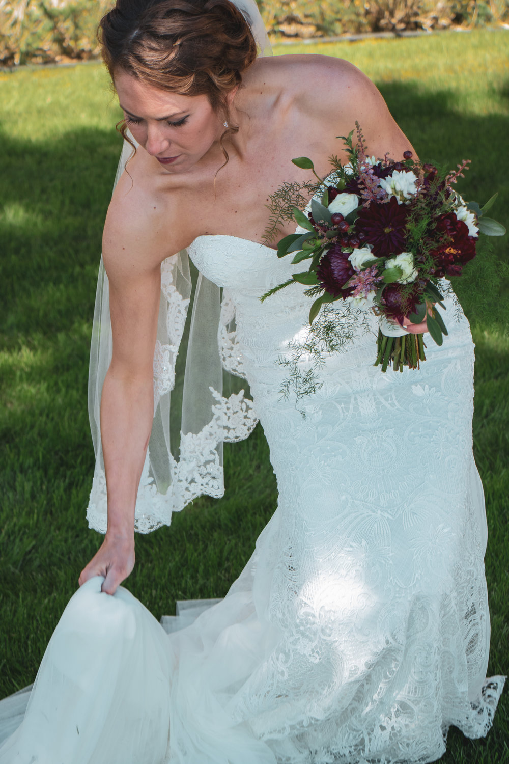 The bride photographed with flowers before her wedding in Lewistown, Montana.
