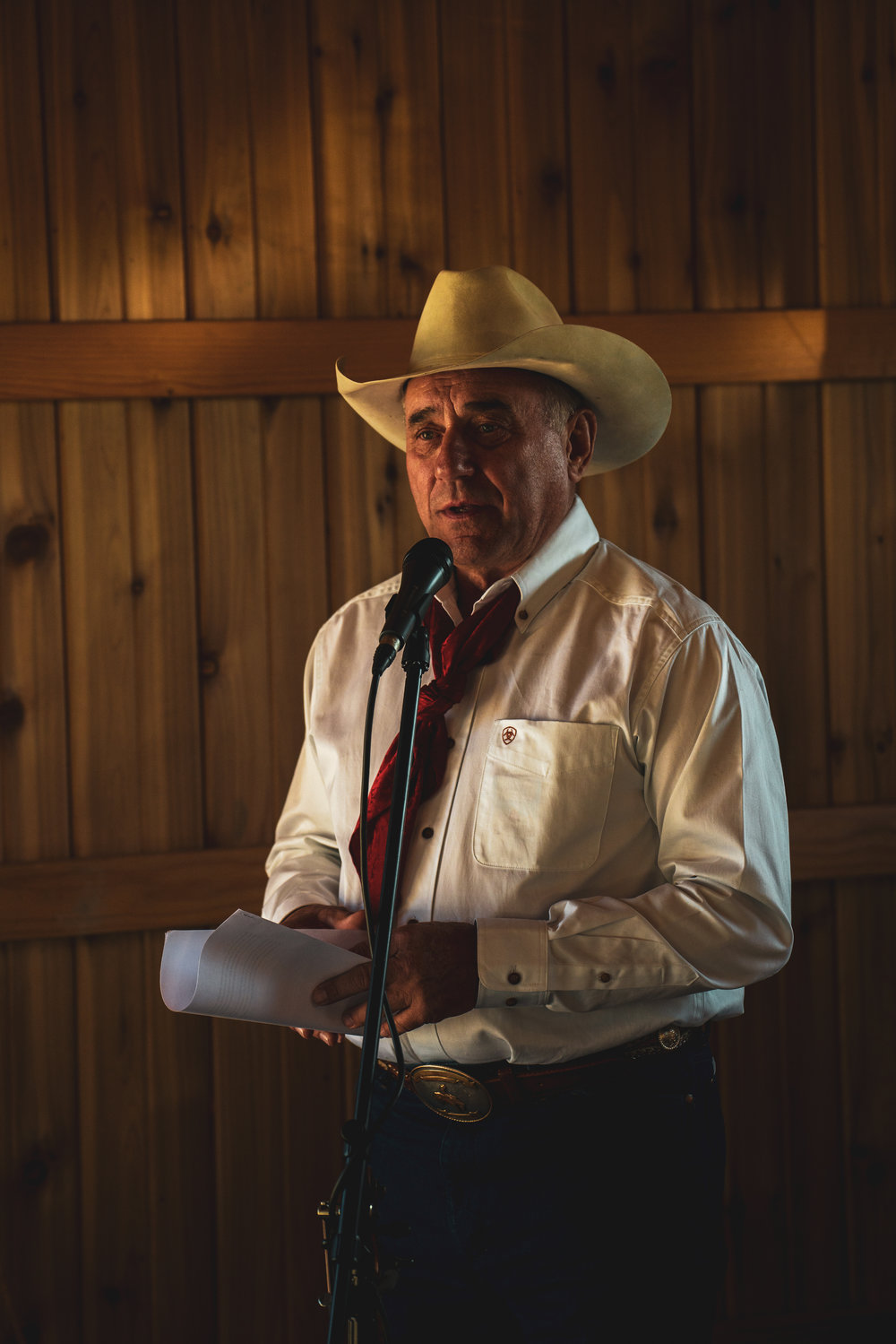 A cowboy poet reading his speech after a wedding in Lewistown, Montana