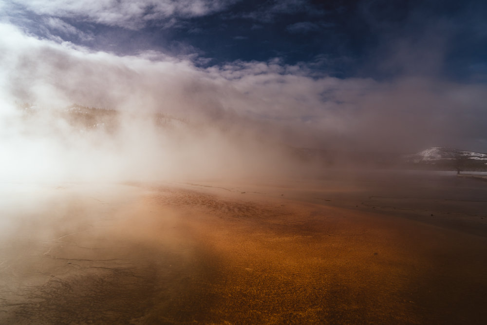 Walking through the steam of Grand Prismatic Spring in Yellowstone National Park.
