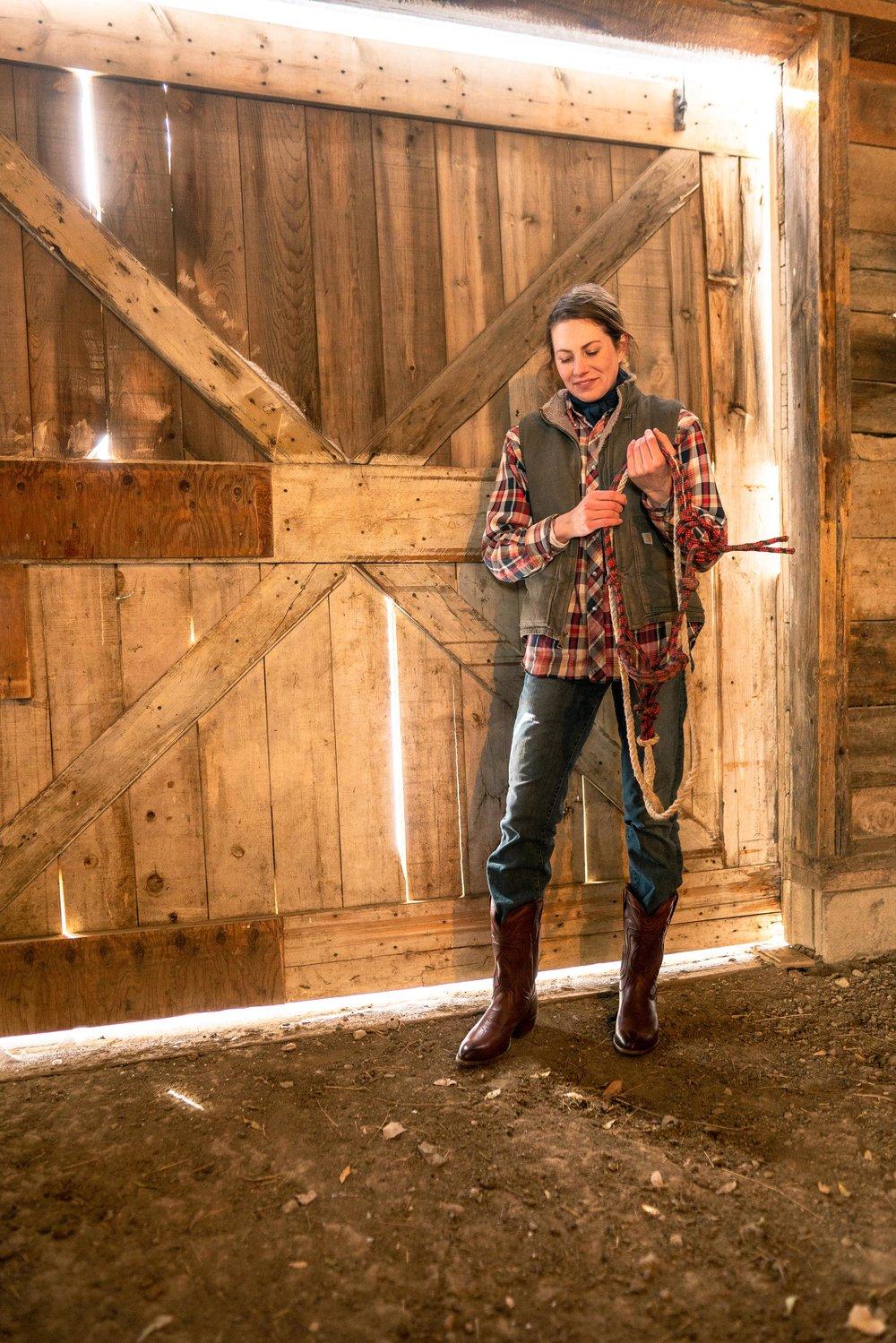 Jenna Flatgard preparing to get her horse in her barn in eastern Montana.