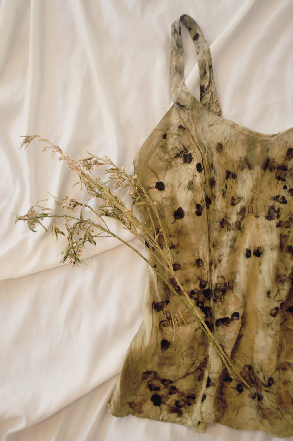 A handmade silk slip dyed with eucalyptus, activated charcoal, dahlias, black tea, and lavender.