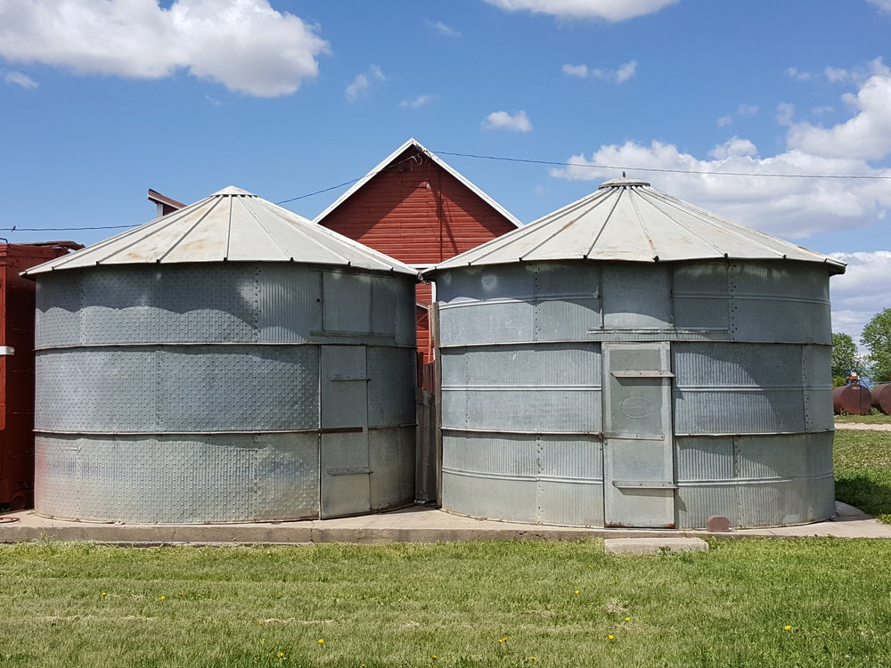 View of the tin granaries from the east side of the farm yard.
