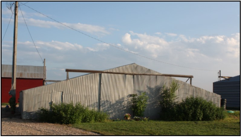 View of the pole machinery shed from the north side of the building.