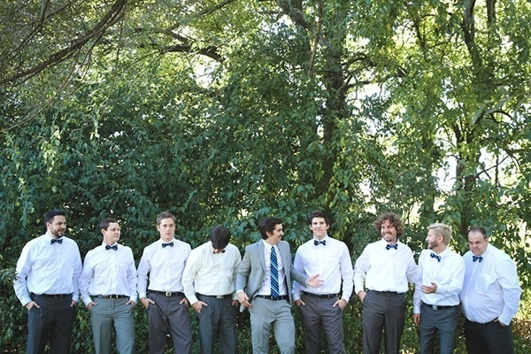 The groom and his groomsmen in dapper bowties