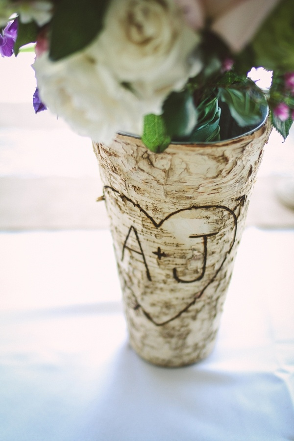 Wedding reception vase decor with a shabby chic vibe
