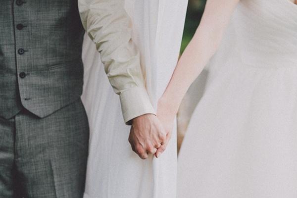 Bride groom holding hands photo