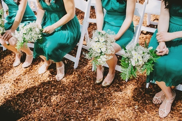 Green bridesmaids dresses with simple white and green bouquets