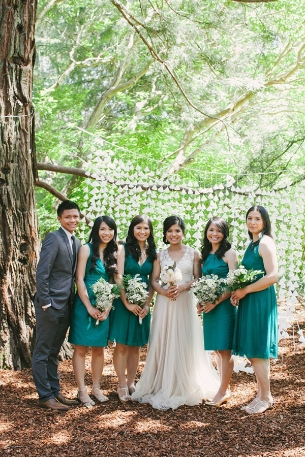 Lovely shot of the bridesmaids in green dresses. Love this!