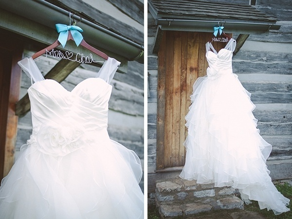 A fluffy white wedding dress with the cutest hanger