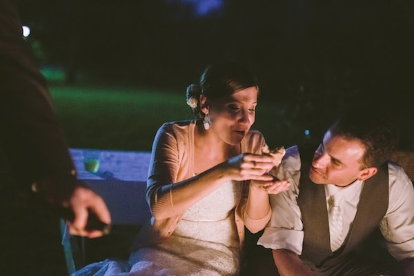 Adorable bride eating S'mores at her wedding!