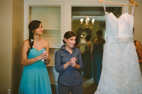 Gorgeous bride admiring her wedding dress!