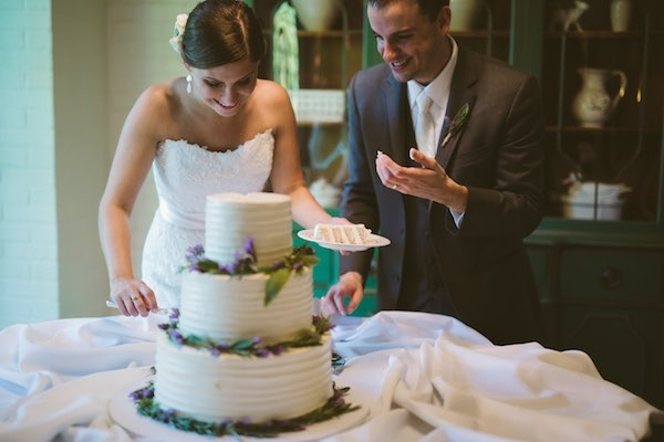 Adorable bride and groom cutting the cake!