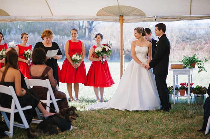 Tented wedding ceremony in the fall, bride groom