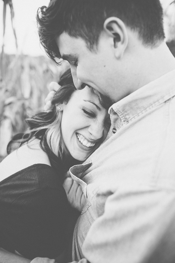 Engagement photos in a corn field. This couple's engagement session was the sweetest!