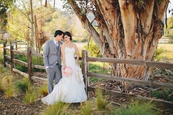 Gorgeous bride and groom in a rustic setting on their wedding day.