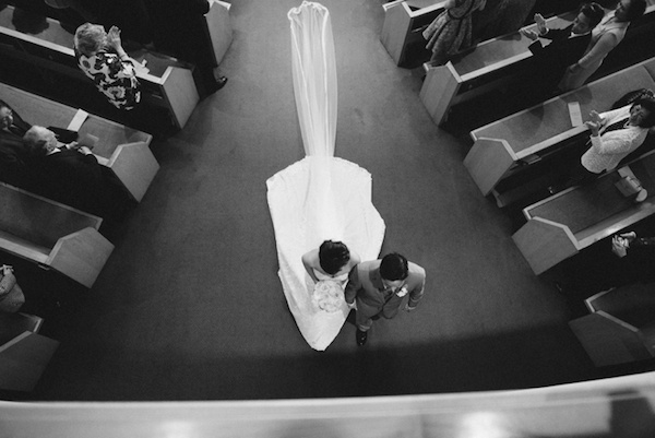 Amazing way to capture a brides long veil and train as she walks out of the church.