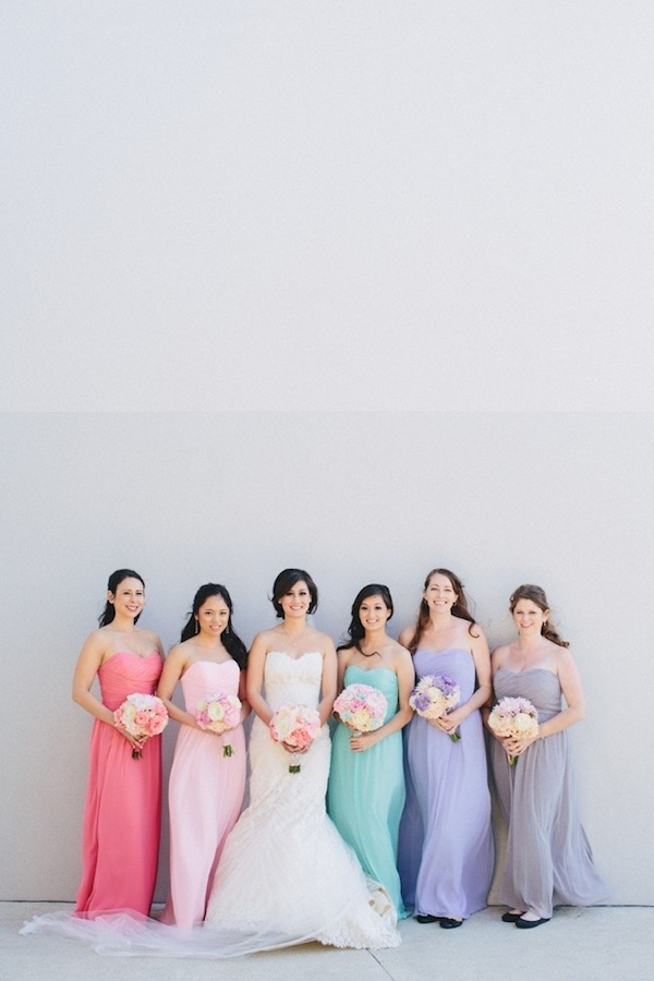 Gorgeous bride with her bridesmaids dressed in pastel.