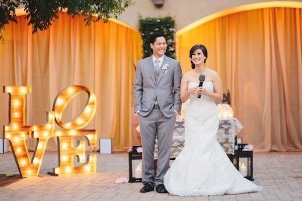 Bride and groom talking.