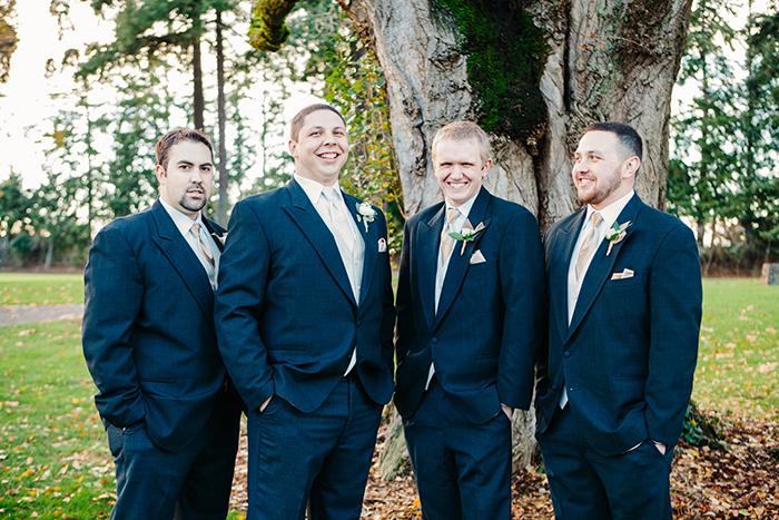 Groom and groomsmen in navy blue suits