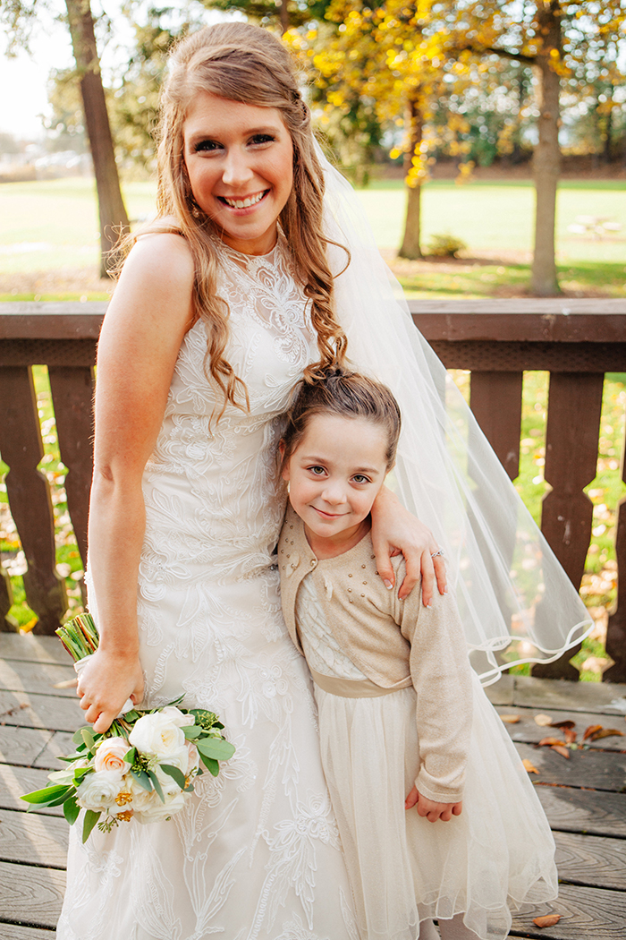 Sweet photo of the bride and her flower girl