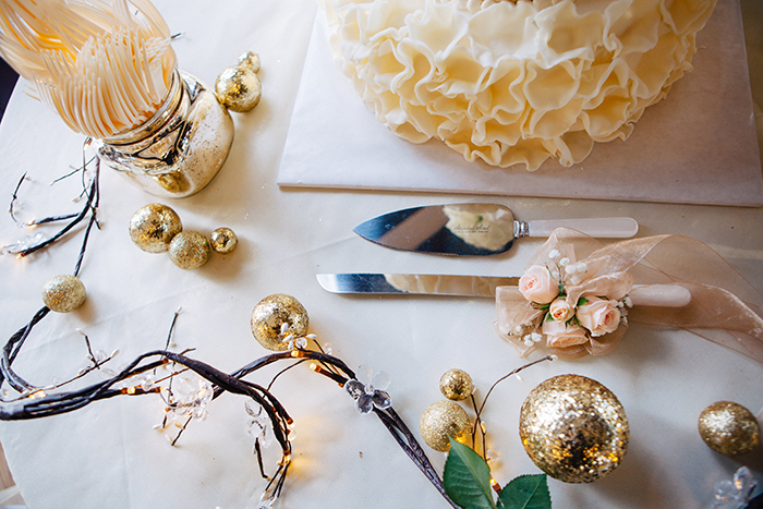 Whimsical white and gold wedding decor