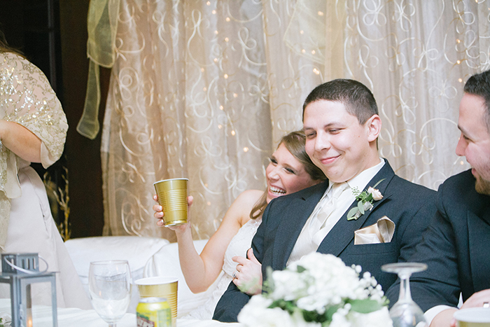 Sweet photo of the bride & groom at the reception
