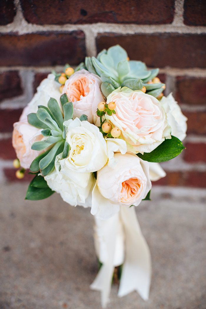 Wedding bouquet with succulents and a rose