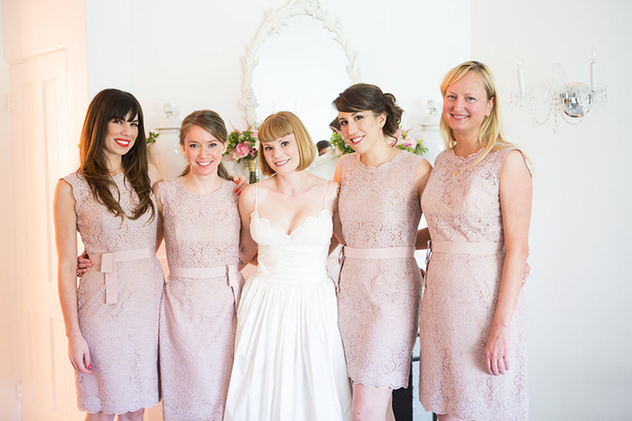 The bride and her bridesmaids in blush pink