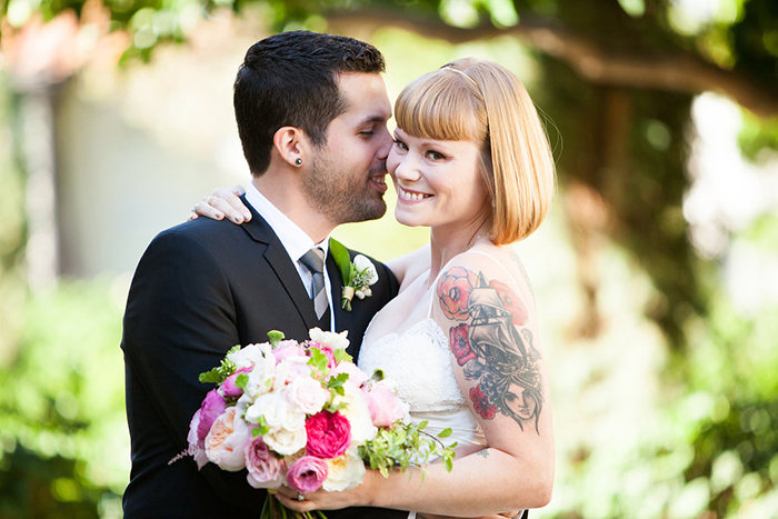 Gorgeous tattooed bride and her groom