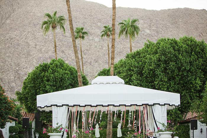 Retro pink and gold wedding ceremony decor