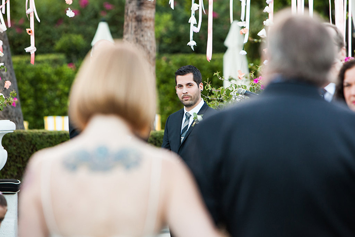 The groom at the end of the aisle — not enough people get this photo!