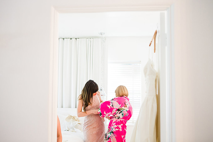 The bride and a bridesmaid getting ready! Sweet photo!