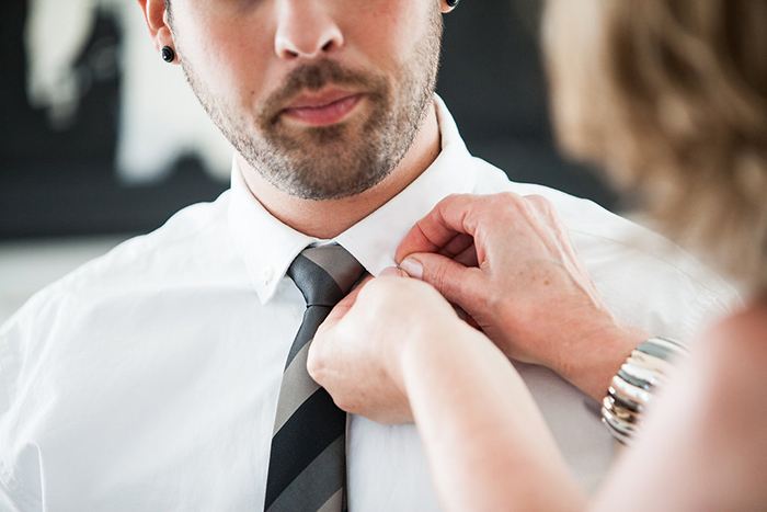 The groom with a simple striped tie