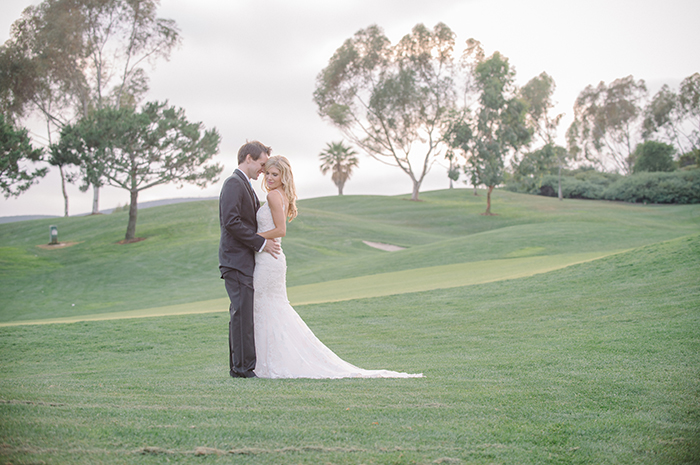 Lovely romantic wedding photo at a golf course