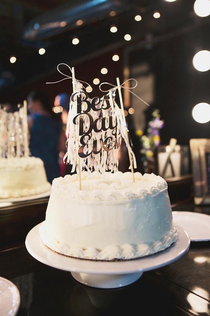 Fun wedding cake and cake topper