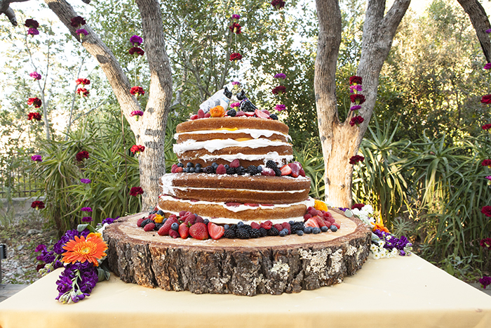 Naked wedding cake with fruit. So simple and pretty!