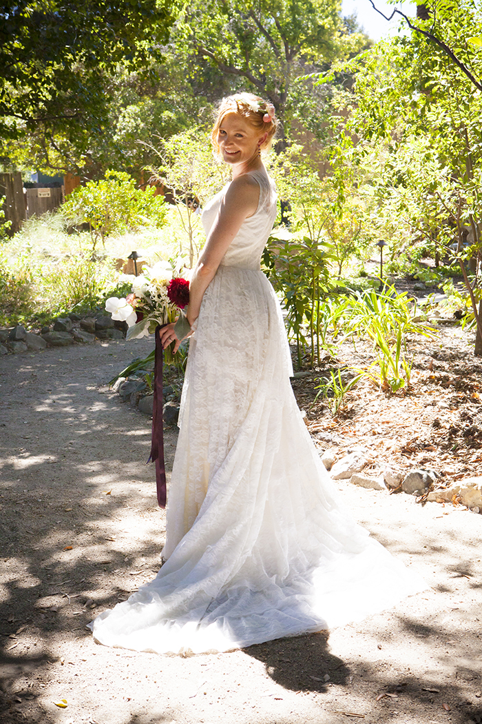 Stunning classic summer bride in a lace wedding dress