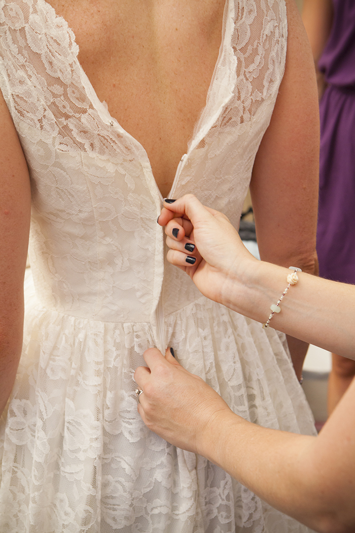 Lace wedding dress getting ready photo