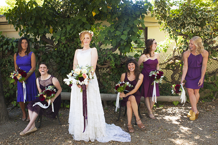 Bridal party with mismatched blue and fuchsia dresses