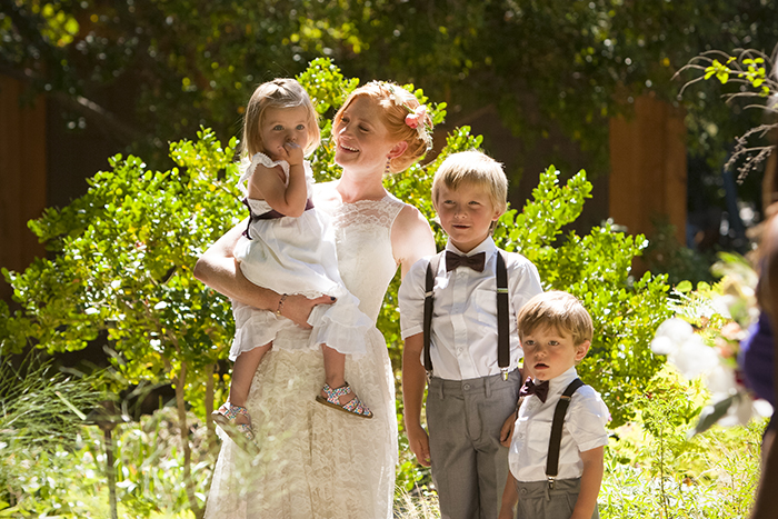 Lovely photo of the bride with ring bearers and flower girl