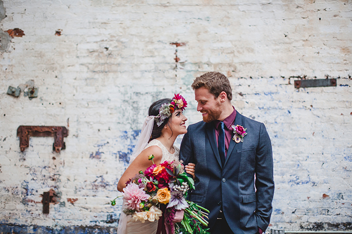 Gorgeous boho bride and a dapper groom in navy and berry