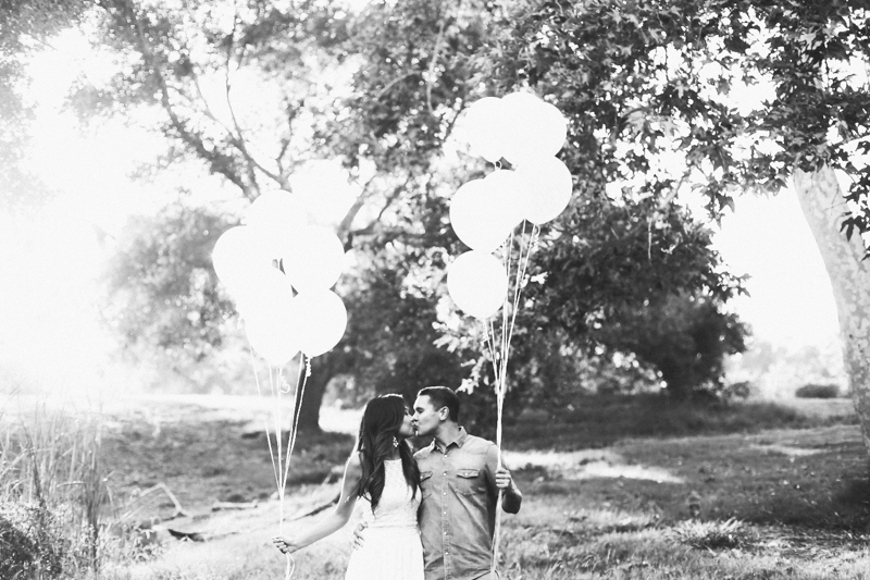 Gorgeous park engagement photos with balloons. Love their outfits!
