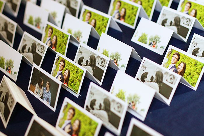 Fun placecards using the bride and groom's engagement photos