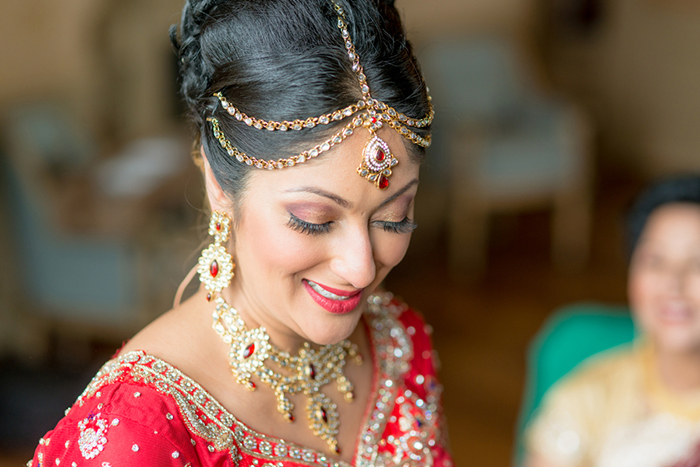 Stunning Indian bride in red and gold