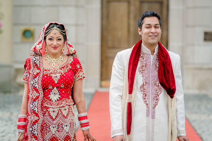 Stunning colorful Indian bride and groom at their castle wedding