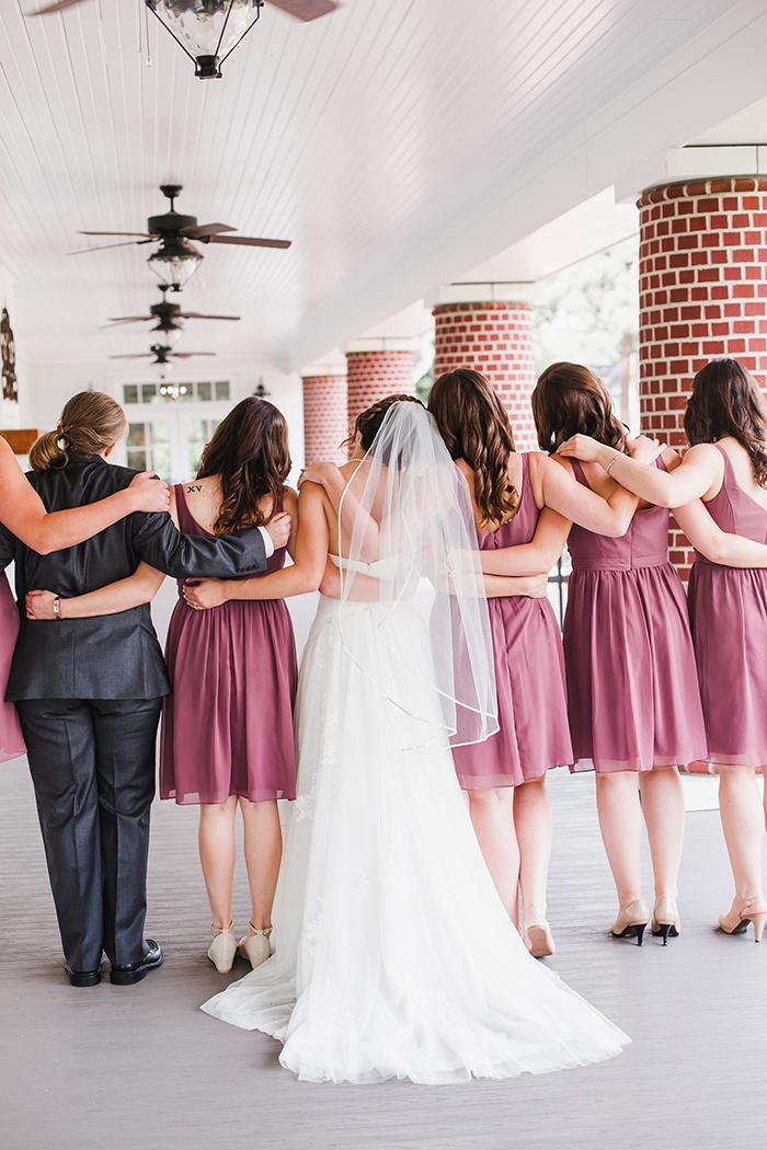 Beautiful bridesmaids in purple